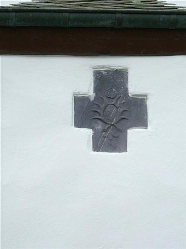 Kreuz über Eingang